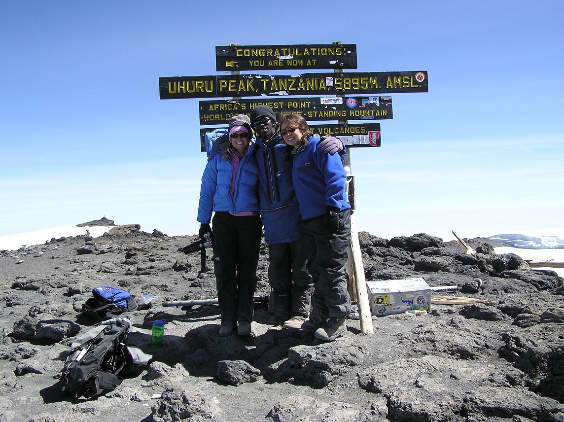 Reggie (left) at the summit of Mt. Kilimanjaro
