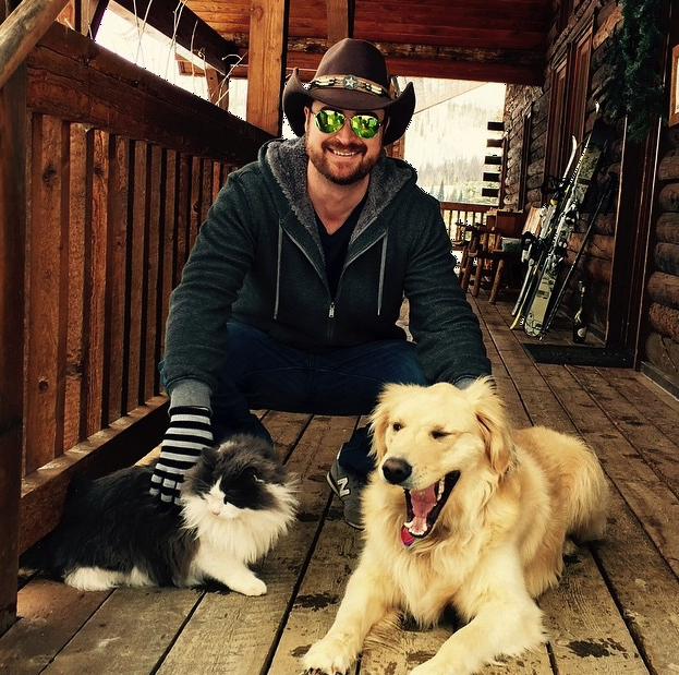 City slicker with newfound friends Blue the Cat and Finn the Dog at Vista Verde Ranch in CO