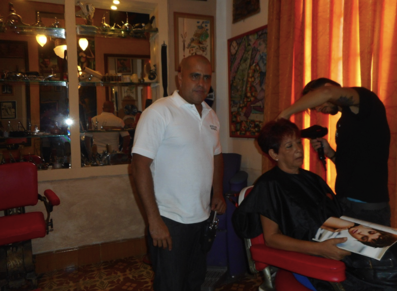 Gilberto Valladares Reina in his hairdressing salon and museum in Old Havana