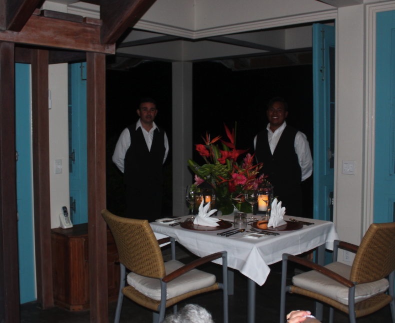Our housemen prepared to serve dinner in our villa at Cayo Espanto