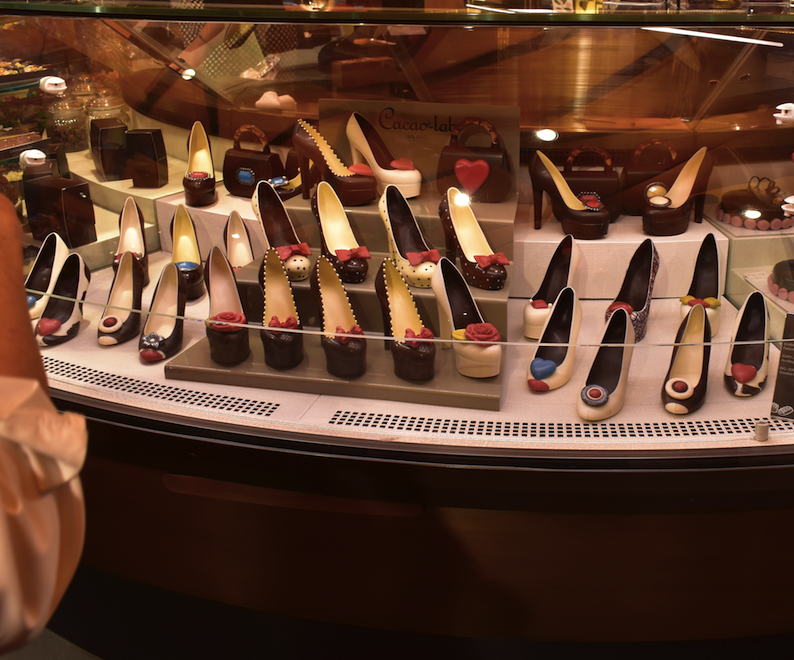 Fashionable chocolate shoes on the food floor of Rincente Department Store in Milan