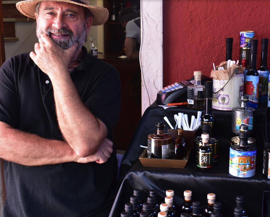 Street vendor selling olive oil and balsamic vinegar