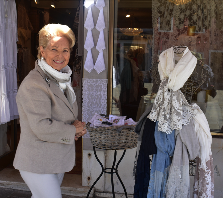 Selling lace scarves and more in Burano