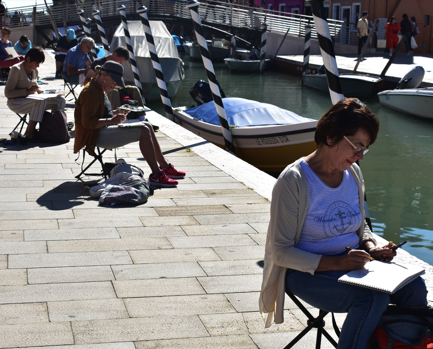 Painters are work along Burano's main canal