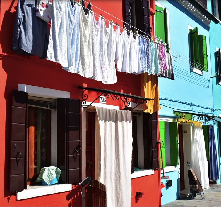 Brightly colored houses and laundry in Burano