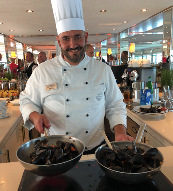 Chef Bogdan serves freshly harvested mussels aboard River Countess
