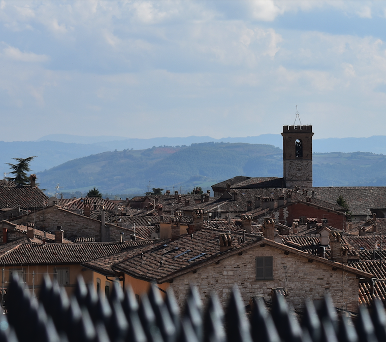 View over the wall from the main plaza in Gubbio. The spikes are not to keep out barbarians, but to keep modern barbarians from sitting on the wall!