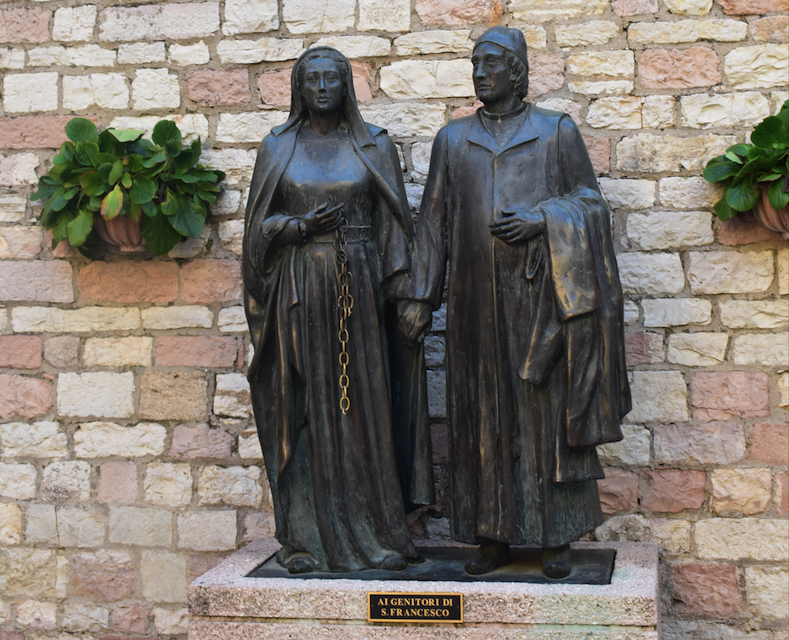 Sculpture in Assisi of the wealthy parents of St. Francis who by most accounts were not very nice