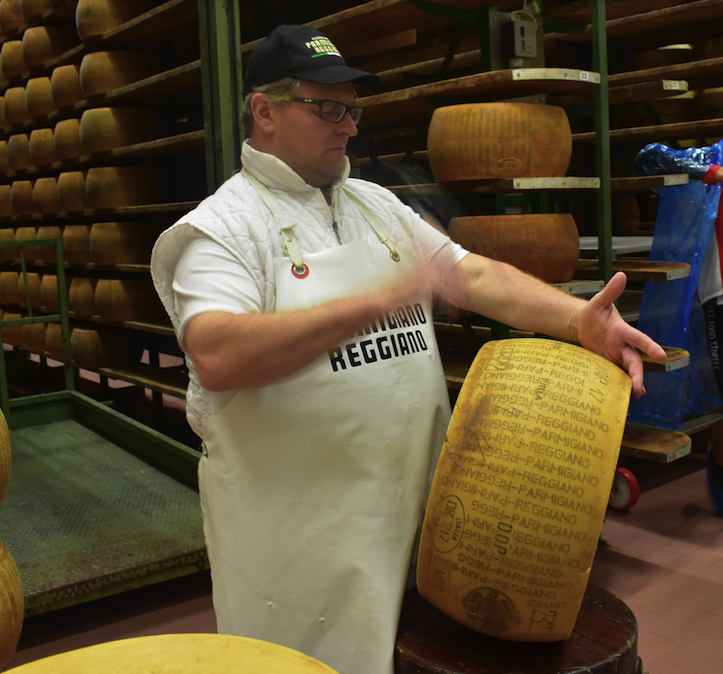 Cheese master at work in Parma