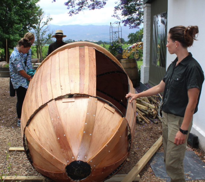 Tracy Van Wik explains an acorn pod that will hang from the trees at the Tree House