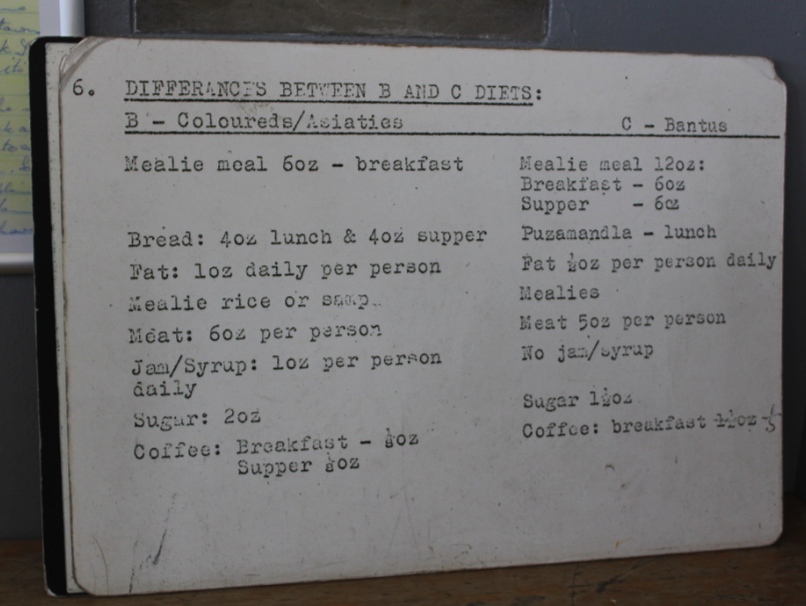 """Sign describing the diets of """"colored"""" and """"asiatic"""" prisoners on Robben Island"""