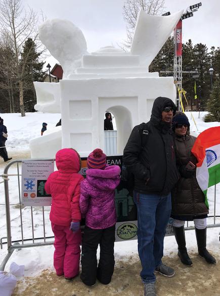 Young art critics judging snow sculptures