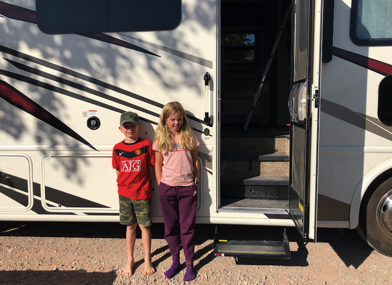 Carl and Asta Dam next to their RV at the KOA Moab campground