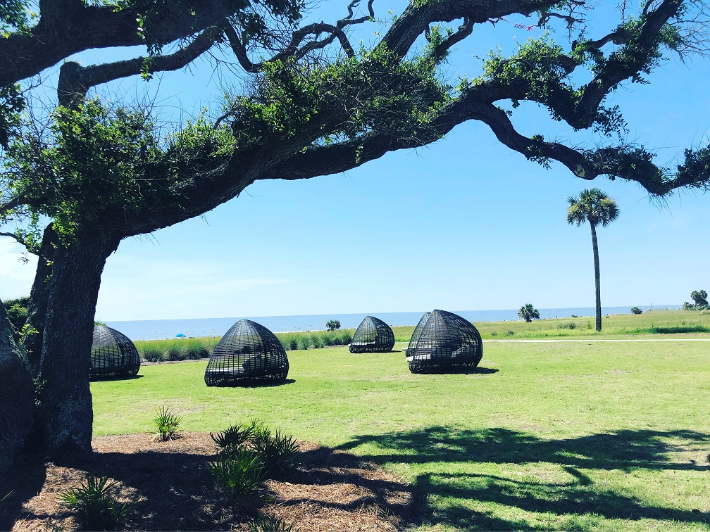 Spend an afternoon reading a book under one of the Holiday Inn Resort's pods by the beach
