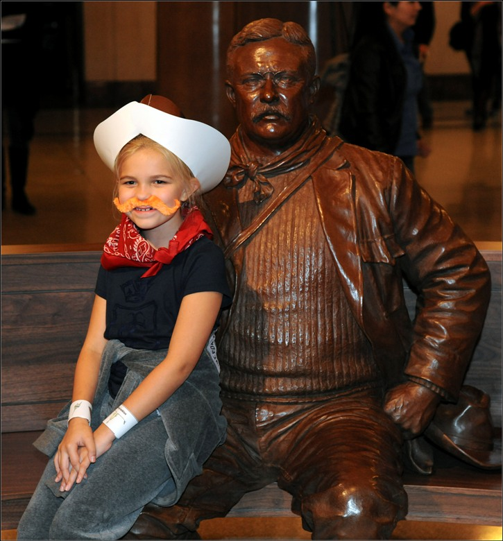 Teddy Roosevelt dressed up to tour Yellowstone with young visitor at AMNH in NYC