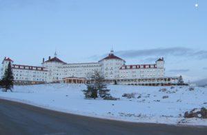 The Omni Mount Washington Hotel at sunset under a full moon on Christmas Eve