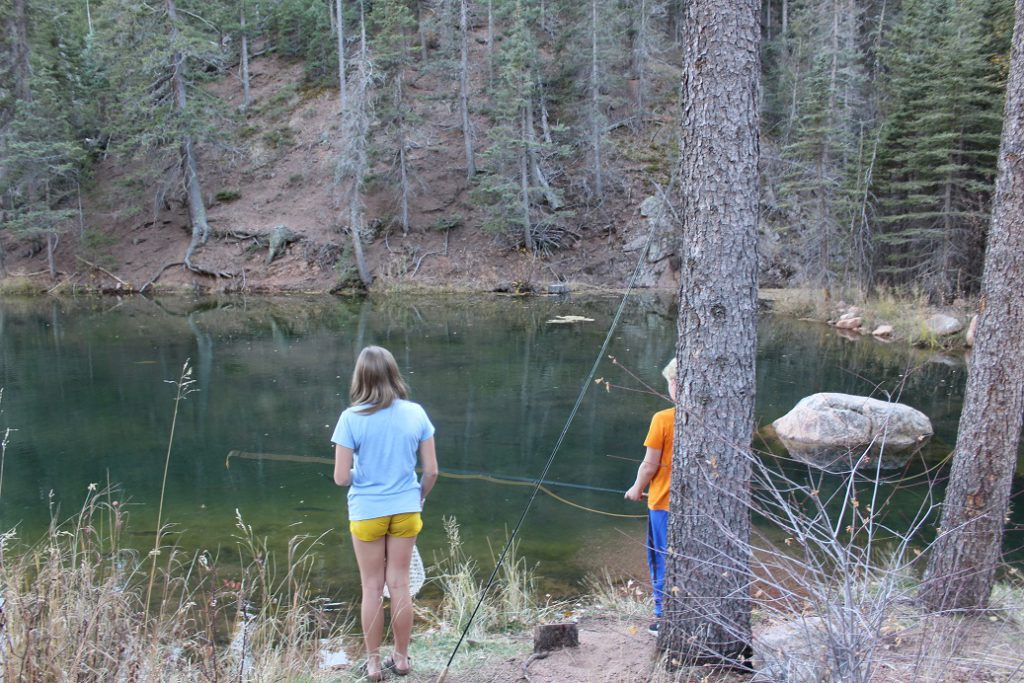 The Trainer kids fishing in one of The Ranch at Emerald Valley ponds