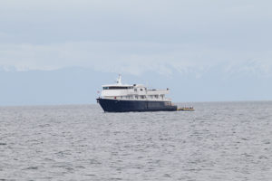 One of Discoverer's sister ships Safari Explorer passes by