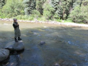 Zach Lewis wrestles with his fly-caught trout near Aspen