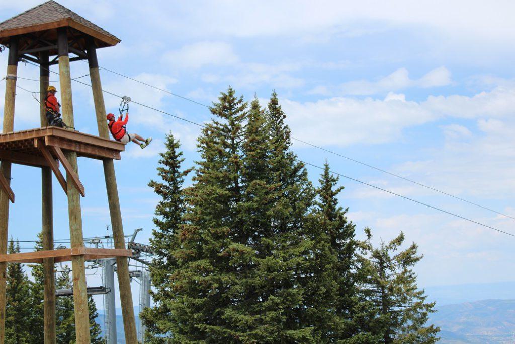 Ziplining atop Vail Mountain