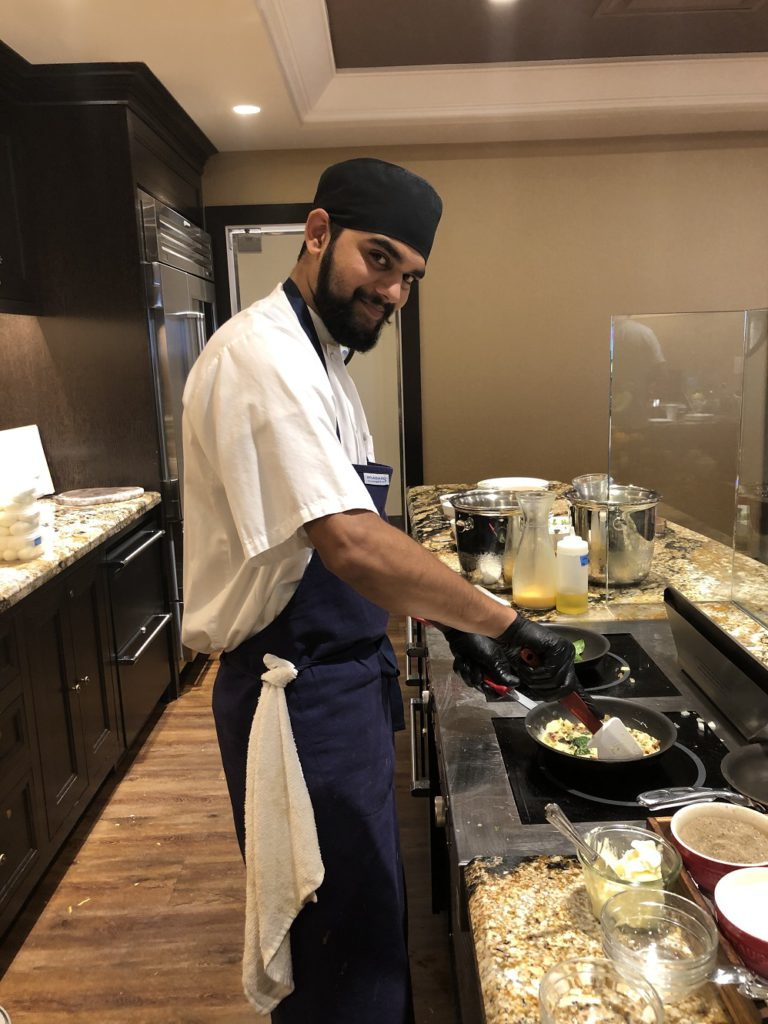 Chef making omlettes on in Gold Lounge at Fairmont Austin