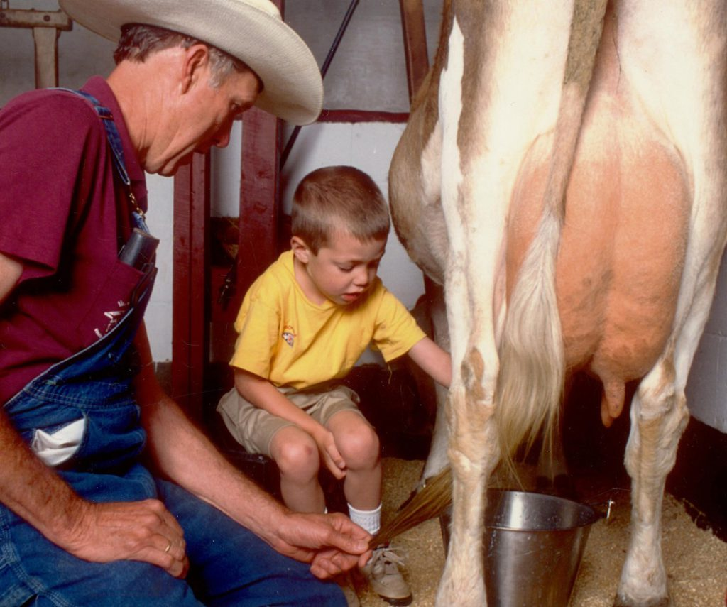 Cow milking with Farmer Dave at The Inn at East Hill Farm