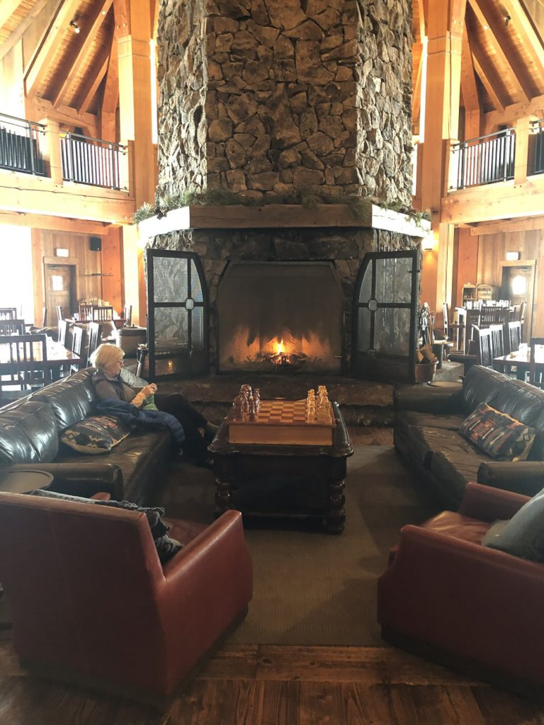 Cozy fireplace in Heck's Tavern at Devil's Thumb Ranch