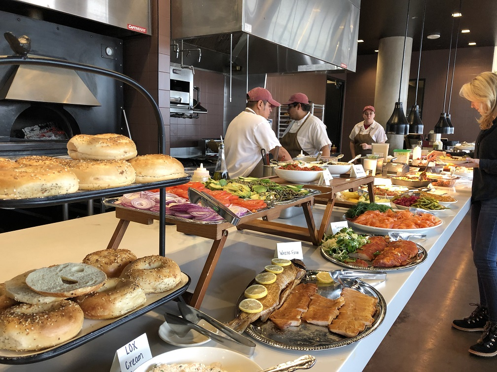 The Sunday brunch buffet line featuring bagels, lox, smoked fish, salads, eggs and much more at Safta in Denver