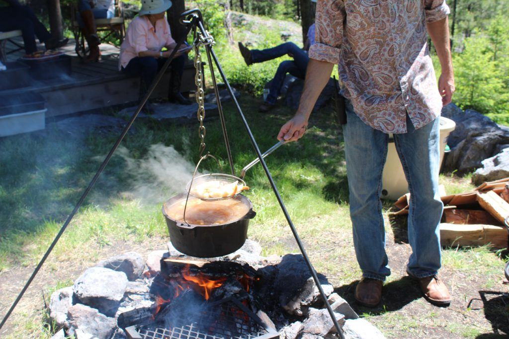 Veggie paella and seafood boil cooking on horseride lunch at Flathead Lake Ranch