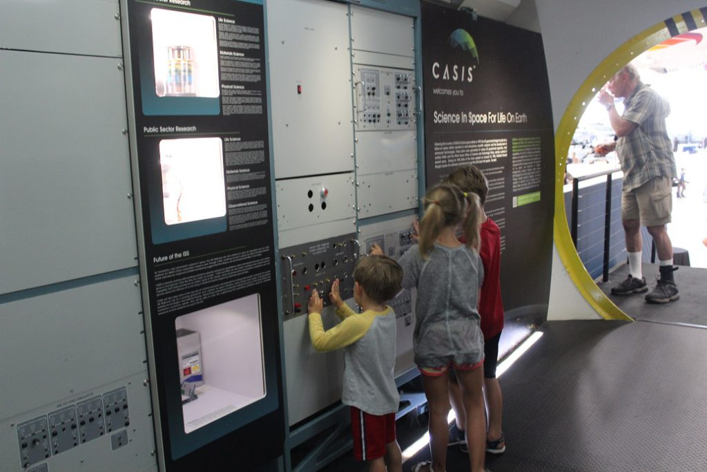 Kids playing with knobs and switches like those found on spacecraft