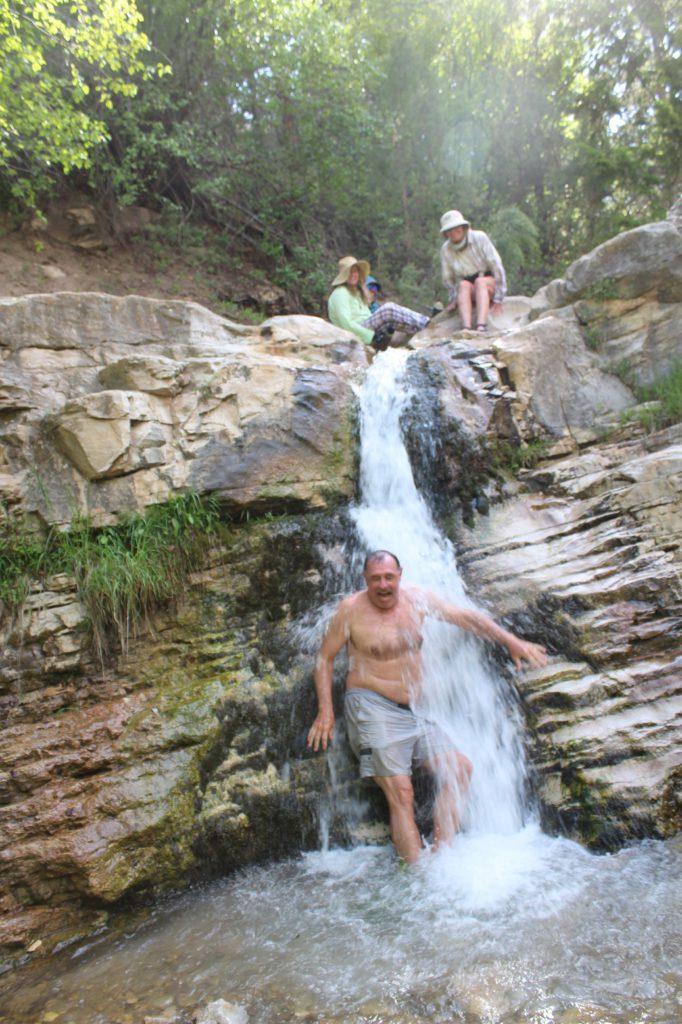 Layne Lisinbee from San Diego enjoys a frigid showed in Ely Creek Falls