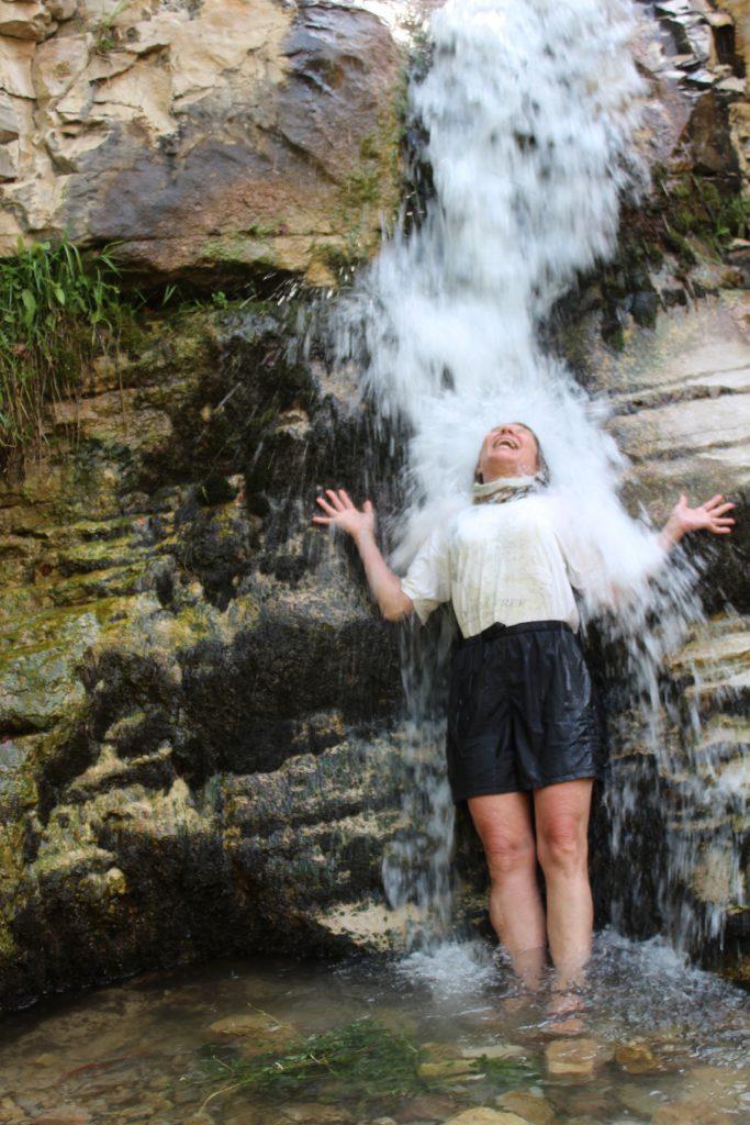 Pam Jones enjoying a very cold dip under Ely Creek Falls