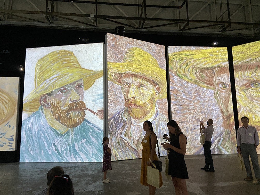 Visitors taking in the images at the Van Gogh exhibit