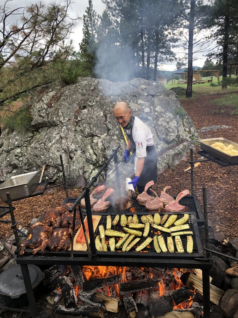 Paws Up Executive Chef Sunny Gin prepares Chuck Wagon dinner feast