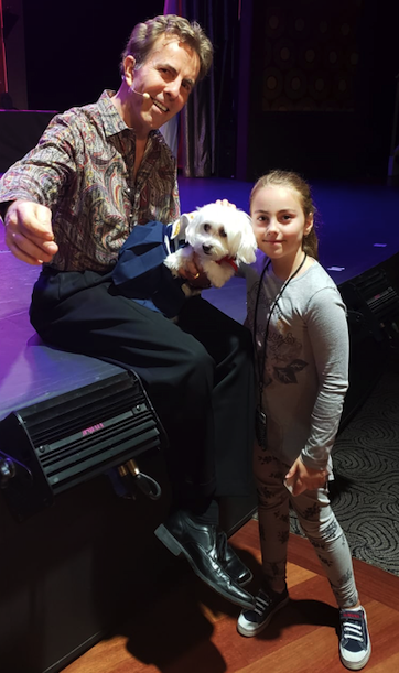 Jeff Peterson, his dog and Alexandra in the ship's theater