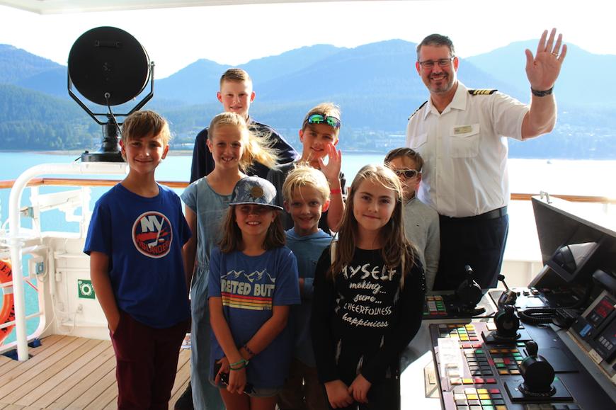 Kids visit the bridge with Captain Palm on the Regent Seven Seas Mariner