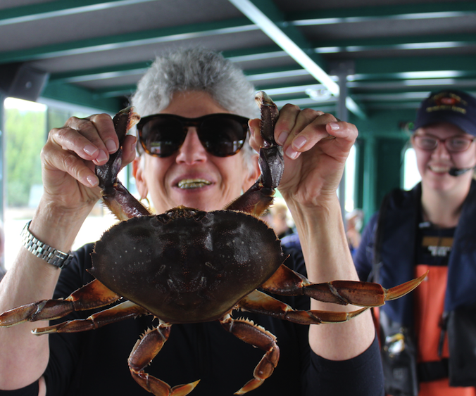 Eileen and a Dungeoness Crab on an excursion near Ketchikan