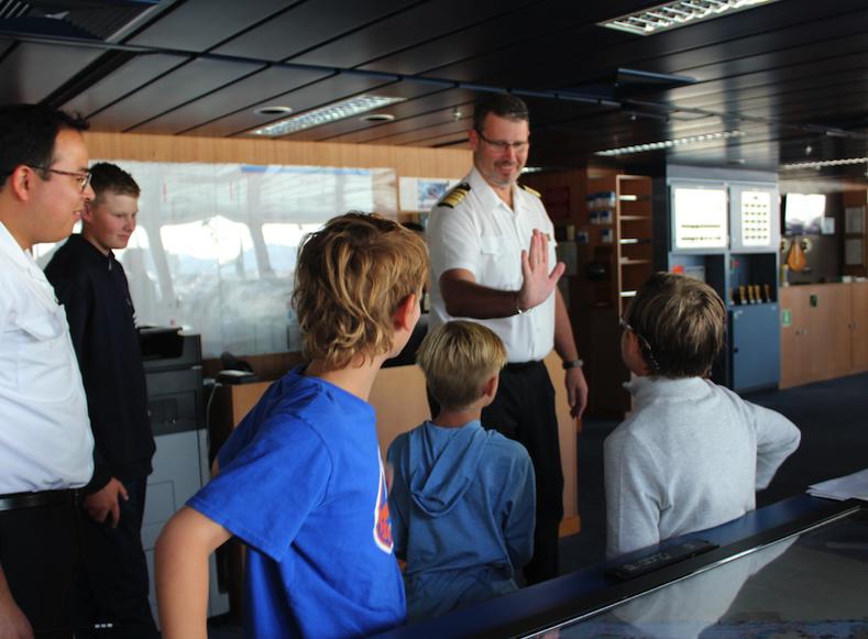 Kids meet the Captain of the Mariner on the Bridge