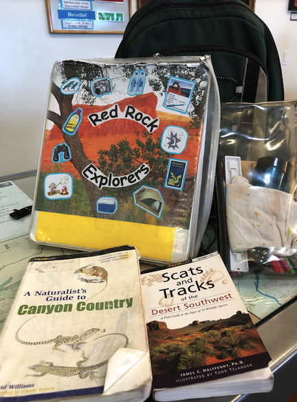 Ingredients of a loaner backpack for kids at the National Parks
