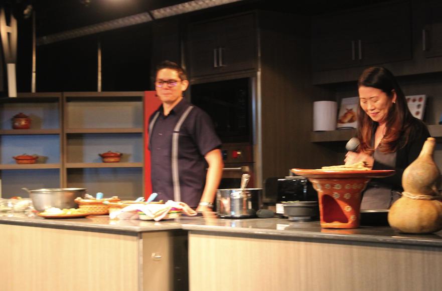 "Edgar Jimenez and Betty Ann Chun at ""divorced eggs"" cooking class aboard Oosterdam"