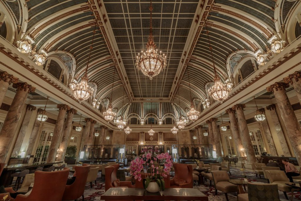 The Palace Hotel's historical glass-domed atrium, opened in 1909, is the setting for brunch or tea
