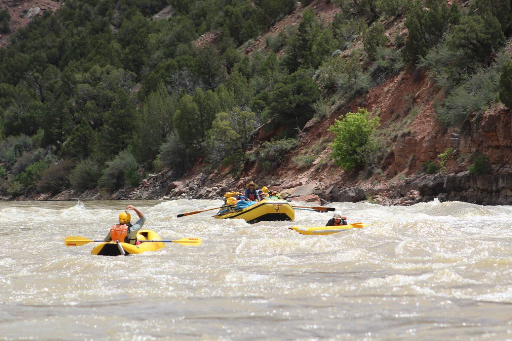 Two 'duckies' (inflatable kayaks attacking some class 2.5 rapids