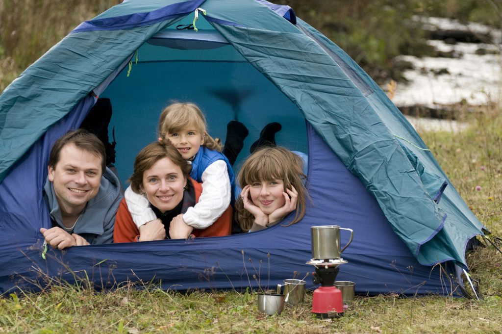 Family camping in tent. (Dreamstime/TNS)