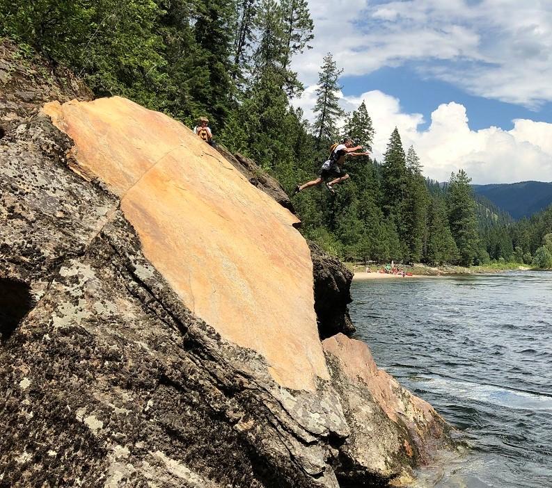 Dan Casler jumps while Jack studies technique