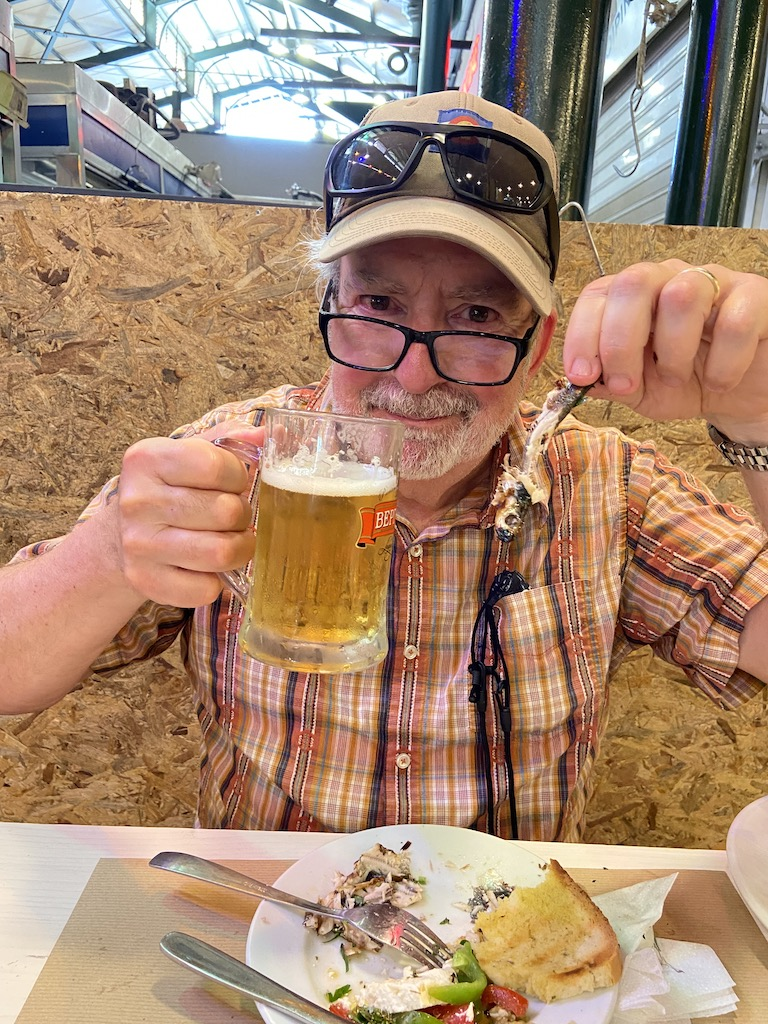Enjoying grilled Sardines and beer at Maxitopa in Athens Central Market