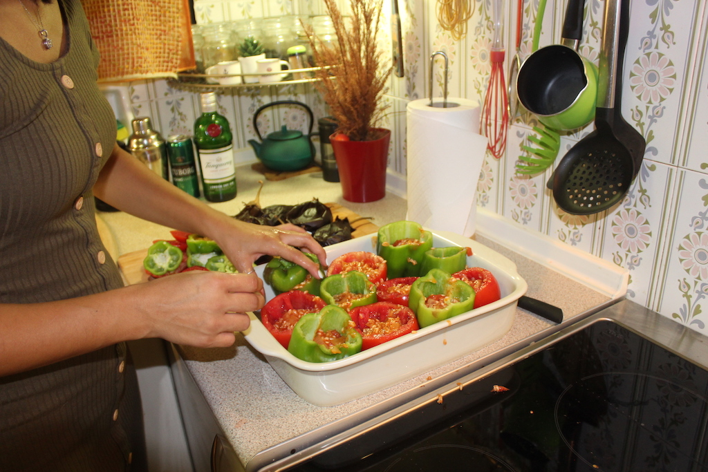 Preparing the stuffed tomatoes and peppers