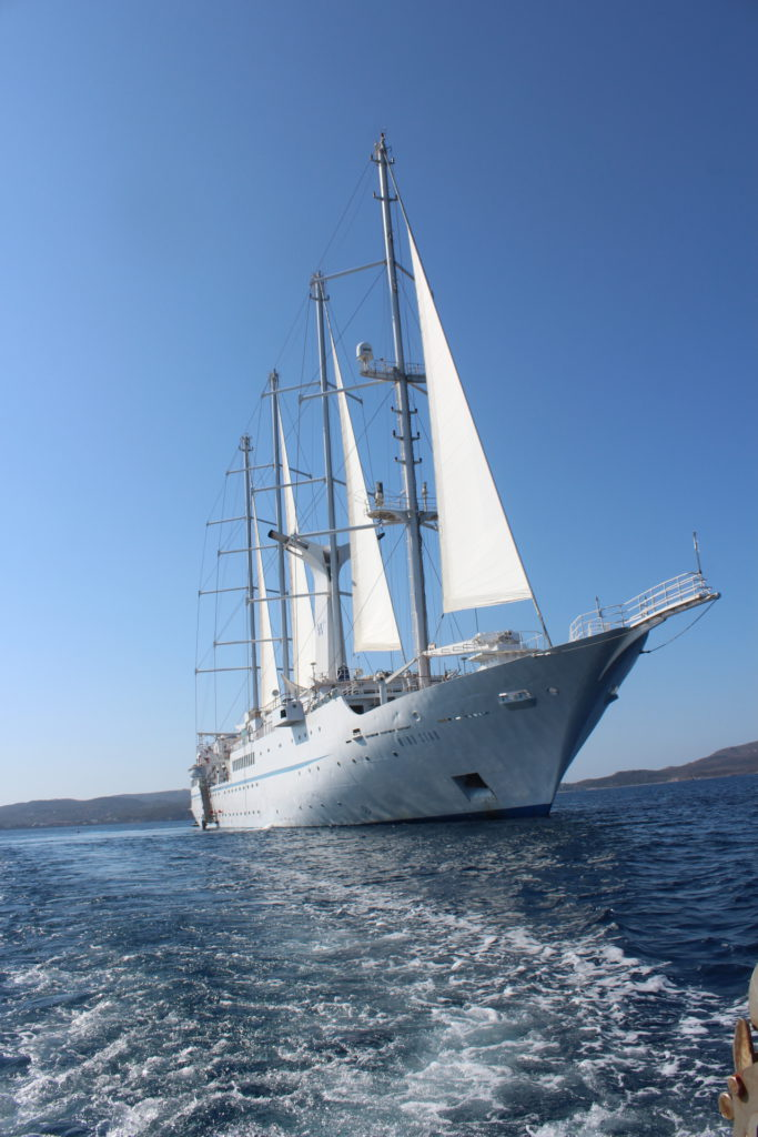 The Wind Star anchored in the harbor of Milos