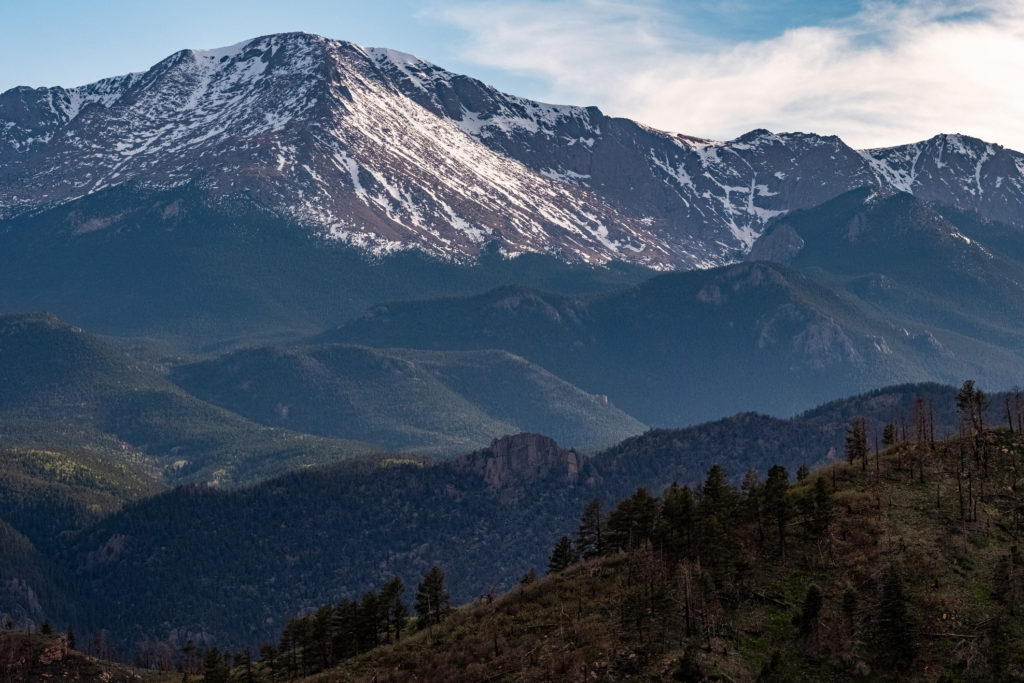 Pikes Peak mountain range seen from rampart range road in Colorado Springs during the summer.