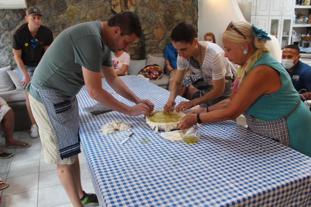Guests from the Celebrity Apex excursions helping make traditional Greek spinach pie