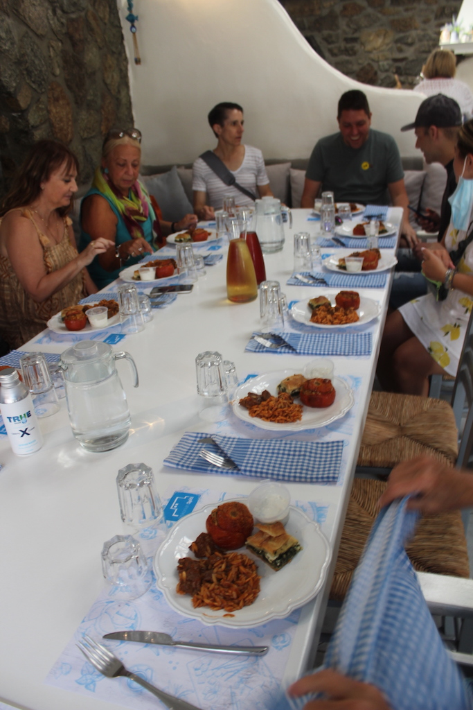 Apex guests sit down for lunch after the cooking class